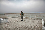 "Armenian Soldier on guard duty at the trenches on the front line with Azerbaijan, by the city of Agdam...Agdam is a ghost town which once had 160,000 residents and an airport. Under Armenian control since July 1993, most of the refugees from Agdam now live in camps and makeshift cities in Azerbaijan. Because of the level of destruction the city ruins are commonly known as the ""Hiroshima of Karabakh.""Officially  cease-fire line is called ?Nagorno Karabakh Line of Contact ?..As the USSR crumbled, Armenia and Azerbaijan fought a war over Nagorno-Karabakh, a regional conflict that was never fully resolved when Stalin redrew borders and placed the largely Armenian populated region within Azeri jurisdiction. With Russian help, Armenia took control of the region by 1994, resulting in an estimated 800,000 displaced Azeris and 230,000 Armenians. The conflict remains unresolved, both sides still regularly exchange small arms fire. The conflict is the main obstacle to any plans for any Transcaucasus project.."