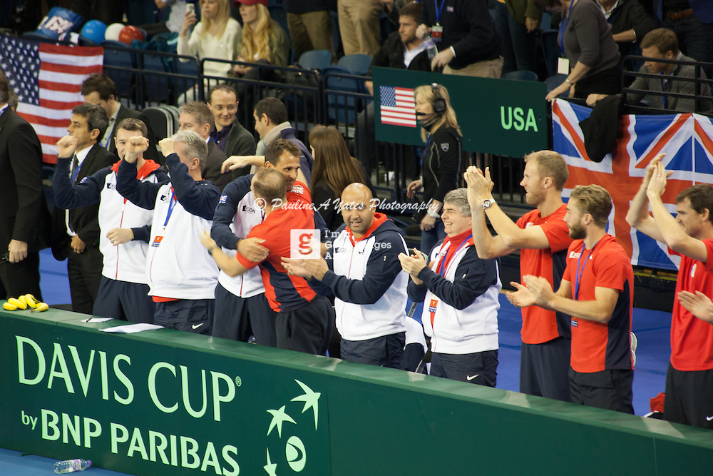 Team GB coaching team celebrate Andy Murray's win over John Isner, and Team GB's Davis Cup win