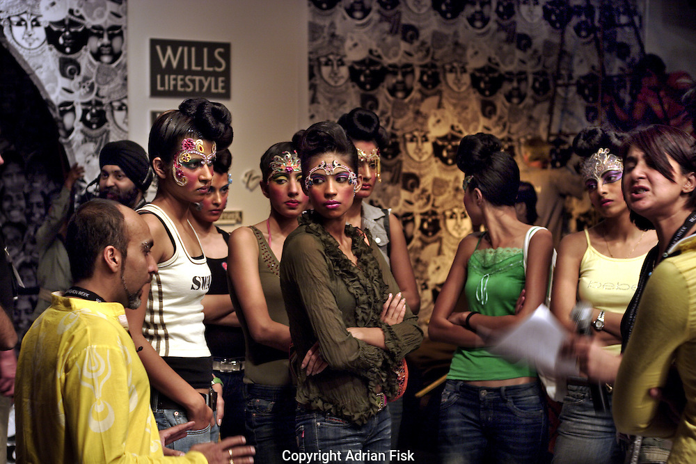 Manish Arora goes through last minute details with models before his show - India fashion week, Autumn - winter collections, New Delhi, April 2006