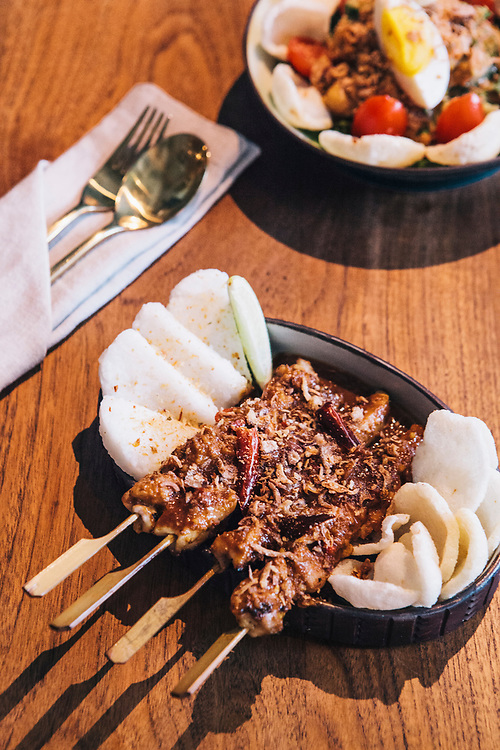 Sate Ayam Bumbu Kacang (chicken satay served with compressed rice cake and mixed nut sauce) with Gado Gado from Kaum restaurant at Potato Head Hong Kong