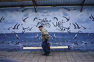 Odessa Downtown, a man crries a piece of wood, Odessa , Ukraine.