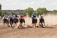 Quarter Horse Racing at Miles City Bucking Horse Sale in Montana.