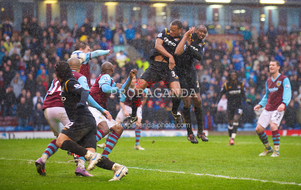 BURNLEY, ENGLAND - Saturday, April 3, 2010: Manchester City's Vincent Kompany scores the sixth goal against Burnley during the Premiership match at Turf Moor. (Photo by David Rawcliffe/Propaganda)