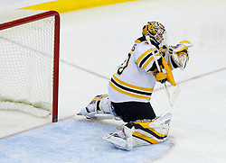 Dec 23, 2008; Newark, NJ, USA; Boston Bruins goalie Tim Thomas (30) makes a save during the third period at the Prudential Center. The Bruins defeated the Devils 2-0.