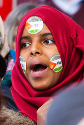 London, August 23rd 2014. A woman chants slogans as hundreds of pro-Palestine protesters outside Downing Street demand that Britain stops arming Israel.