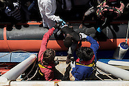 Italy: MSF Dignity1: An African man rescued at the sea is helped to get on the Dignity1 on August 23, 2015. Alessio Romenzi