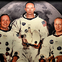 Apollo 11 Crew as First Men on the Moon at Johnson Space Center in Webster, Texas<br /> With only five months left before John F. Kennedy&rsquo;s deadline to land a man on the moon, Neil Armstrong declared on July 20, 1969, &ldquo;Houston, Tranquility Base here. The Eagle has landed.&rdquo; Early the next morning, after descending a nine-rung ladder, he said, &ldquo;That&rsquo;s one small step for a man, one giant leap for mankind.&rdquo; Near the historic MOCR2 (Mission Control Room) at Johnson Space Center in Webster, Texas, is this portrait of the Apollo 11 crew: Neil Armstrong, Michael Collins and Buzz Aldrin.