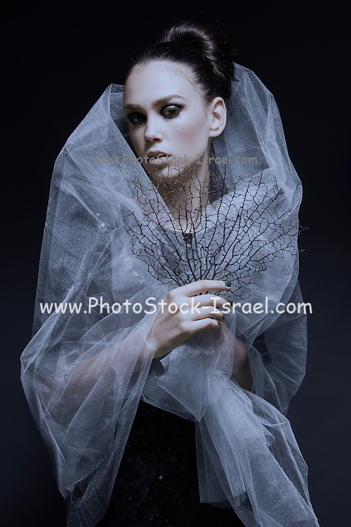 Atmospheric image of a veiled woman on black background