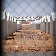 The camp is designed with six villages, three of which have been built. From Village Three (currently the only occupied village) you lookout onto Village Five. Azraq camp for Syrian refugees, Jordan, May 2015.