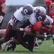 William Penn running back Kamau Floyd (6) is tackled by Concord linebacker Avery Roberts (11) during a regular season football game between William Penn and Concord Saturday, Oct. 24, 2015 at  William Penn High School in New Castle.