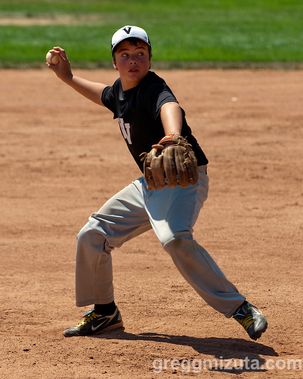 Tanner Hamilton pitches during the Snake River Slug Fest Baseball Tournament at Mesa Recreation Park in Fruitland, Idaho on July 27, 2013.