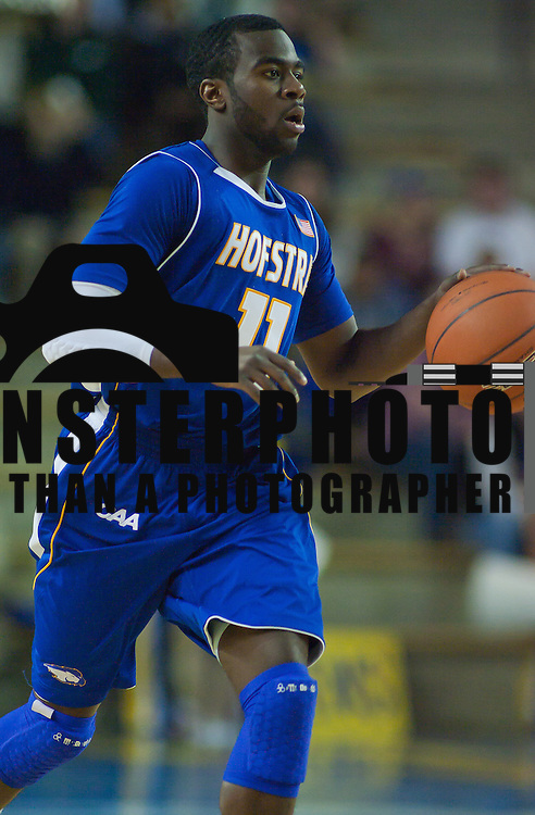 01/04/12 Newark DE: Hofstra Senior Guard Dwan McMillan #11 running the floor during a Colonial Athletic Association basketball game against Delaware Wed, Jan. 4, 2012 at the Bob carpenter center in Newark Delaware...Moore scored 24 points to lead Hofstra while Nathaniel Lester added 15 points and 11 rebounds, McLendon contributed 11 points, and Stephen Nwaukoni pulled down 12 rebounds before fouling out.