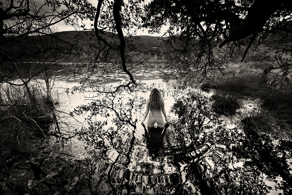 Selected Print for the IN:SIGHT (Washington Green) New Artists Competition 2015<br /> <br /> Nominee in 10th Annual Black &amp; White Spider Awards<br /> <br /> &quot;The woman stood motionless, or so it seemed, her feet slowly sinking into the sticky black leaf litter below the surface. There was hardly a breeze, no movement, just the occasional chirp from the Summer&rsquo;s last Swallow, breaking the silence at this mountain lake.&nbsp;But when you look closely, you see ripples oscillating away from the woman&rsquo;s body, continuing almost imperceptibly across the lake. Her energy, her life force was affecting the landscape in a clearly visible, tangible way, utter connection between our living organic form and the earth we come from.&rdquo;<br /> <br /> &quot;Landscape Figures&quot; explores the relationship between organic human figures and a notional 'wild landscape'. <br /> <br /> &ldquo;Although the nude is vital to the project and integral within the images, the images are not just &lsquo;nudes&rsquo; &ndash; they are landscapes and stories. In a way they are just simple, beautiful, dreamlike visual questions&rdquo;.
