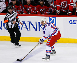 April 9, 2008; Newark, NJ, USA;  New York Rangers center Scott Gomez (19) skates with the puck during the third period of game 1 of the Eastern Conference Quarterfinal playoffs at the Prudential Center in Newark, NJ.  The Rangers defeated the Devils 4-1 to take a 1-0 lead in the best of 7 series.  Gomez had 3 assists.