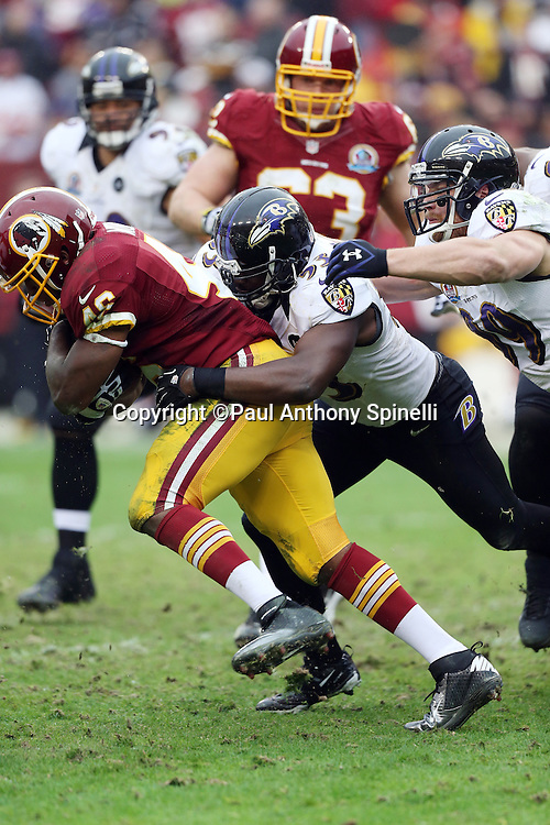 Baltimore Ravens inside linebacker Jameel McClain (53) tackles Washington Redskins running back Alfred Morris (46) during the NFL week 14 football game against the Washington Redskins on Sunday, Dec. 9, 2012 in Landover, Md. The Redskins won the game in overtime 31-28. ©Paul Anthony Spinelli