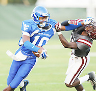 Water Valley's L.J. Hawkins (10) breaks an attempted tackle by New Albany's Cris Farr (10) at Bobby Clark Field in Water Valley, Miss. on Friday, August 22, 2014. Water Valley won the season opener 36-33.