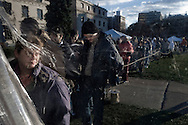 """OHIO, Toledo, October 28, 2012: Those below the poverty waiting on line to go inside for the evening meal of tent city which was arranged in Toledo by the church organization """"1Matters.org"""" to distribute clothes and food. ALESSIO ROMENZI"""