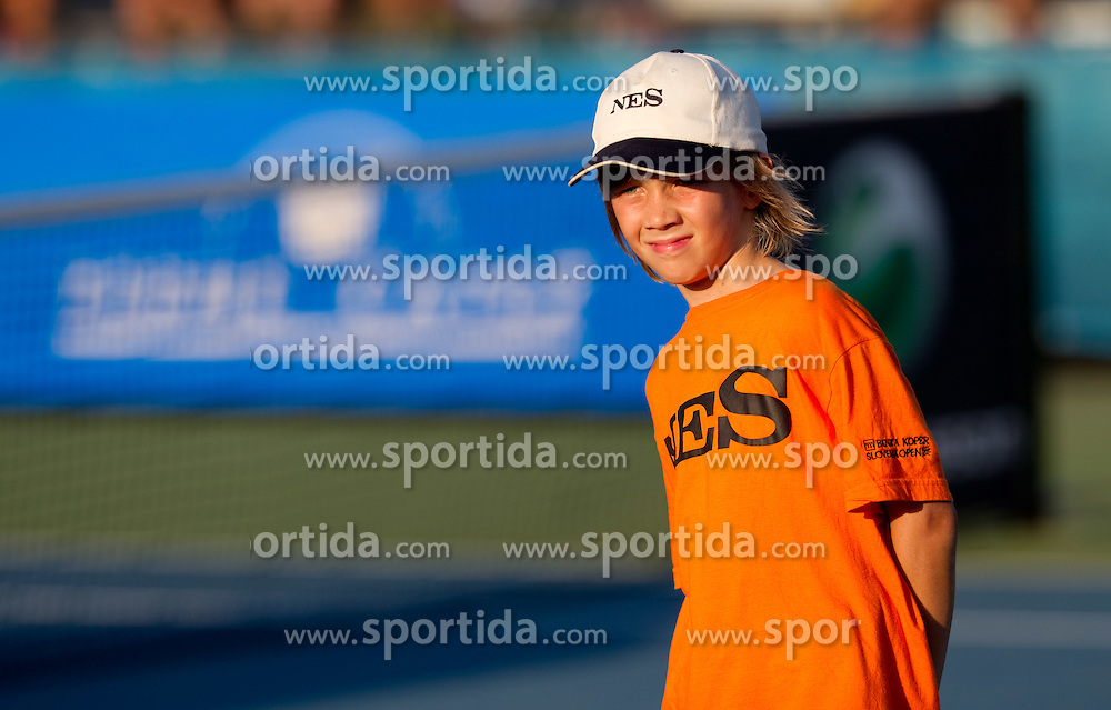 Ball boy at 2nd Round of Singles at Banka Koper Slovenia Open WTA Tour tennis tournament, on July 22, 2010 in Portoroz / Portorose, Slovenia. (Photo by Vid Ponikvar / Sportida)