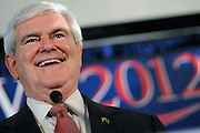COLUMBIA,SC - January 21, 2012: Former Speaker of the House and Georgia congressman Newt Gingrich beams whicle delivering his victory speech in a packed room at the Palmetto State Ballroom at the Columbia, South Carolina Hilton. Gingrich finished first in the third race of this presidential election season with 40% of the vote, Mitt Romney finished second with 28%. Rick Santorum finished with 17% and Ron Paul got 13%. Roughly 442,000 votes were cast.