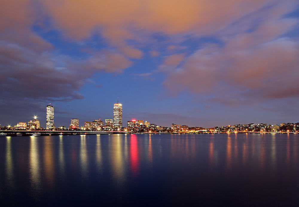 City of Boston skyline photography at twilight showing landmarks such as John Hancock building, Prudential Center and Mass Avenue bridge as seen from Memorial Drive in Cambridge, MA. <br /> <br /> <br /> Pictures of Boston are available as museum quality photography prints, canvas prints, acrylic prints or metal prints. Prints may be framed and matted to the individual liking and decorating needs: <br /> <br /> http://juergen-roth.artistwebsites.com/featured/opening-night-juergen-roth.html<br /> <br /> Good light and happy photo making!<br /> <br /> My best,<br /> <br /> Juergen<br /> www.RothGalleries.com<br /> www.ExploringTheLight.com<br /> http://whereintheworldisjuergen.blogspot.com<br /> @NatureFineArt<br /> https://www.facebook.com/naturefineart