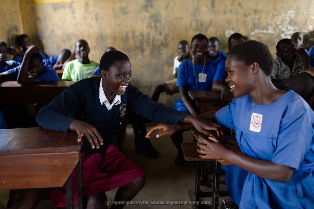 Annette Awuro and Elizabeth Okware in class at Aputiri Primary School in Eastern Uganda on 31 July 2014.