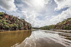 Tourists speed down the Sale River in the Kimberley wet season
