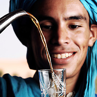 Merzouga, Morocco, 30 October 2006<br /> A berber nomad offers typical tea in Erg Chebbi dunes.<br /> Photo: Ezequiel Scagnetti