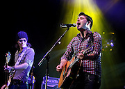 Greg Churchouse and Roy Stride of Scouting For Girls perform live on stage at Wembley Arena on April 8, 2011 in London, England.  (Photo by Simone Joyner)