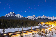 A moonlit nightscape shot from February 2012, with a gibbous Moon providing illumination over the Bow River and Morant's Curve in Banff. Venus is the bright obect over the Lake Louise range mountains. A 30-second exposure at f/2.8 and ISO 400 with the Canon 5D MkII and Canon L-series 24mm lens. This version is with the front of the train going through the scene lighting up the landscape.