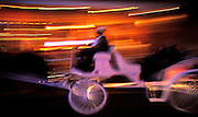 Image of a horse and buggy ride at the Mardi Gras celebration in the French Quarter of New Orleans, Louisiana, American South