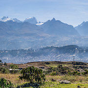 Above Huaraz, see a wide panorama of the Cordillera Blanca, including the world's highest tropical peak, Huascaran (far left). For a good day of acclimatization, bus to Callan Punta (a 4225-meter pass in the Cordillera Negra) then hike down to Huaraz, in the Andes Mountains, Peru, South America. This panorama was stitched from 6 overlapping photos.
