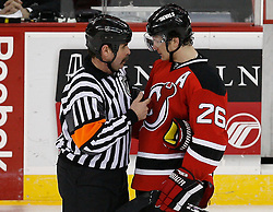 Mar 20, 2009; Newark, NJ, USA; New Jersey Devils left wing Patrik Elias (26) talks to Referee Bill McCreary (7) during the third period at the Prudential Center.  The Devils defeated the Wild 4-0.