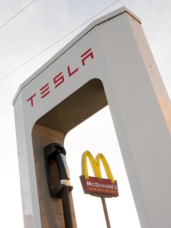 Tesla electric supercharger stations are presently located along west coast interstate routes however the electric carmaker has plans to make the recharging sites as ubiquitous as McDonalds in the U.S.. Superchargers are free connectors that charge Tesla electric cars in minutes instead of hours. Stations are strategically placed to minimize stops and are conveniently located near restaurants, shopping centers, and WiFi hot spots. Each station contains multiple Superchargers.