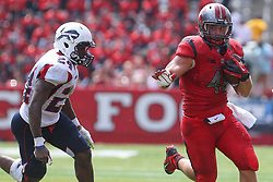 Sep 6, 2014; Piscataway, NJ, USA; Rutgers Scarlet Knights fullback Michael Burton (46) runs with the ball  during the first half at High Points Solutions Stadium.