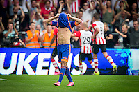 EINDHOVEN - PSV - Feyenoord , Voetbal , Seizoen 2015/2016 , Eredivisie , Philips Stadion , 30-08-2015 , Speler van Feyenoord Bilal Basaçikoglu (l) baalt van de 3-1 terwijl spelers van PSV feest vieren
