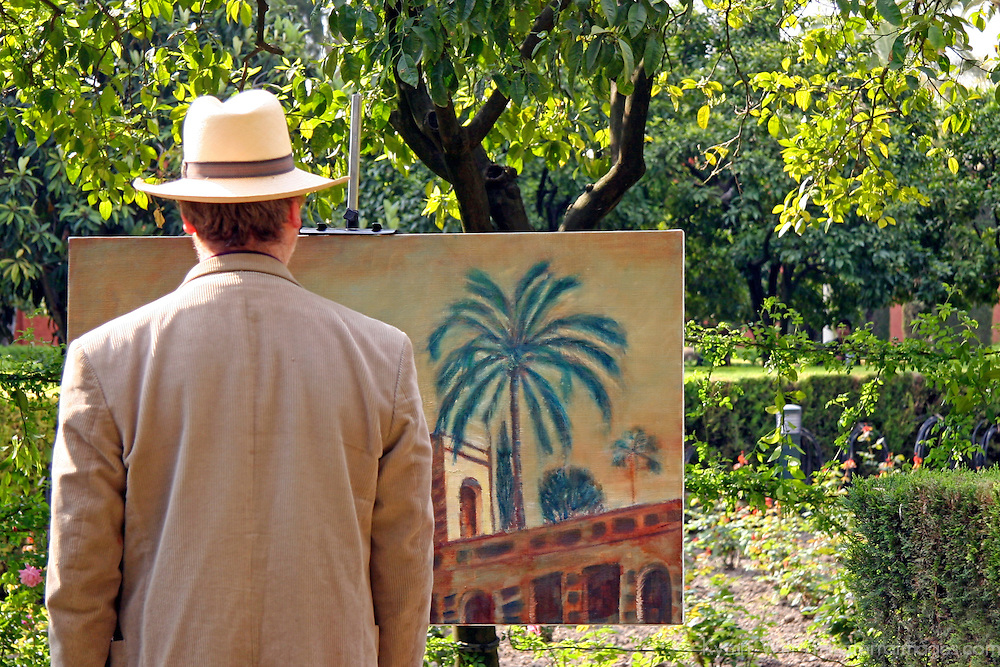 Europe, Spain, Sevilla. Artist at the Alcazar Gardens, Seville.