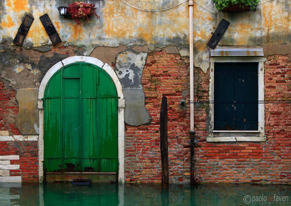 The Facade of a building along Rio della Sensa in Cannaregio, a Sestiere (district) of Venice, Italy