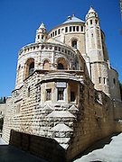 Exterior of the Dormition Abbey, a massive Benedictine basilica, is located at the place where Virgin Mary had fallen asleep for the last time. In the basement of the Abby there is a statue of the sleeping Holy Mother.