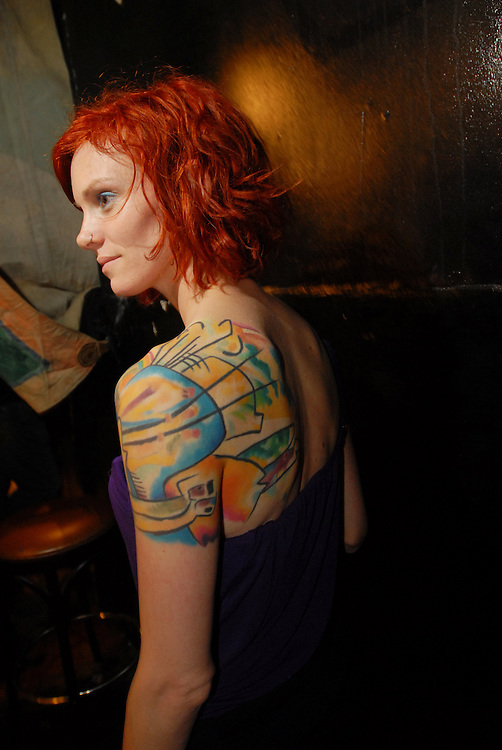 """New York City Tattoo Convention 2009 at the Roseland Ballroom: Natalie Doyle.with an abstract painting, Kandinksy's 'comp iv"""" by Aureole in Brisbane, Australia."""