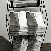 Mira Mexico installation for the 2013 Sondheim Prize Exhibition at The Walter's Art Museum in Baltimore Maryland. Newspapers on a rack for visitors to the museum to take away and hang in public.<br /> (Credit Image: &copy; Louie Palu/ZUMA Press)