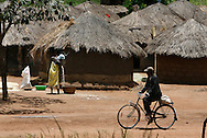 October 7, 2006 - A woman pours maize into a basket in Tetugu camp for internally displaced people, or IDP, near Gulu in north Uganda. Tetugu, with a population of 22,000, is one of 76 IDP camps around Gulu, the main base for the Uganda Peoples Defense Force fighting the insurgent Joseph Kony's Lord's Resistance Army. Kony's LRA movement has been fighting for the past 20 years to force the East African country to be ruled according to the Christian Ten Commandments. Over 2 million people, mostly of the Acholi tribe, have moved or were forced to move from their villages to camps close to the towns of Gulu, Lira, and Kitgum where they are watched over by the Ugandan Army. The LRA rebels have abducted thousands of children and have forced them to fight against the Ugandan Army and the Acholi people. Current peace talks between Kony's LRA and the Ugandan government held in Juba, southern Sudan, offer a glimpse of hope to ending this ongoing conflict..(Photo by Jakub Mosur/Polaris)<br />