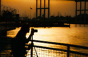 Photographer at Kemah Boardwalk, an entertainment complex in Kemah, Texas, featuring an amusement park, hotel, dining, and music.
