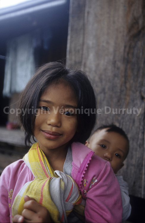 KALINGA - HEAD HUNTERS TRIBE- LITTLE GIRL WITH HER BROTHER, LUZON ISLAND, THE PHILIPPINES