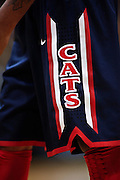 SHOT 1/21/12 6:27:40 PM - Detail of the Cats logo on an Arizona players uniform during their PAC 12 regular season men's basketball game against Colorado at the Coors Events Center in Boulder, Co. Colorado won the game 64-63..(Photo by Marc Piscotty / © 2012)