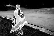 A woman walking through the center towards the new reception building. FEDASIL Sugny asylum center. Sugny, Belgium. August 2015. I took these photographs during an international volunteer program that I liderate with an international volunteering group.