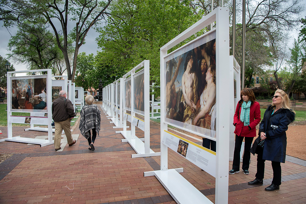 em051017b/jnorth/Mindy Atkin, right, and Jan Guarino, both from Long Island New York, look through The PRADO in Santa Fe exhibit in Cathedral Park Santa Fe, Wednesday May 10, 2017. Guarino is leading an small art class around Santa Fe. (Eddie Moore/Albuquerque Journal