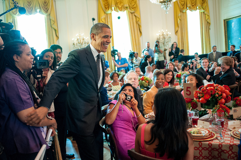 President Barack Obama makes an appearance as First Lady Michelle Obama hosts the first ever Kids' ?State Dinner,? at the White House in Washington, D.C., U.S., on Monday, Aug. 20, 2012. The First Lady invited 54 kids, ages 8-12 representing all U.S. states, three territories and the District of Columbia, to a luncheon featuring a selection of healthy recipes from the Healthy Lunchtime Challenge.The Challenge was created in support of First Lady Michelle Obama's Let's Move! initiative, which aims to help solve the problem of childhood obesity within a generation. Photographer: Pete Marovich/Bloomberg