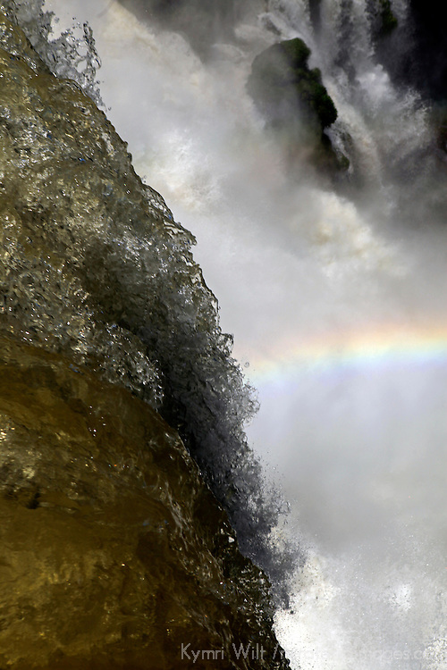 South America, Argentina, Iguacu Falls. Rainbow in the Falls.