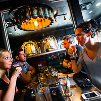 TAMPA, FL -- Amanda King, left to right, David Hill, Steve Larson, and Tegan Foster sample beers at the Cigar City Brewing Brewpub in Tampa, Florida.  (Photo / Chip Litherland)