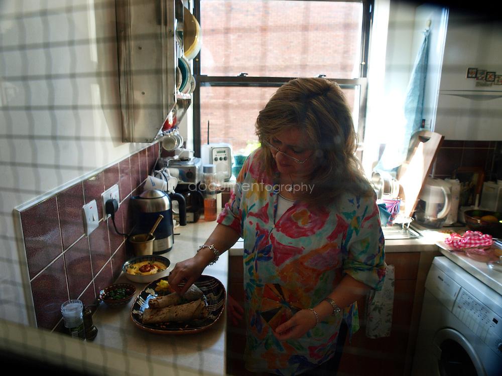 Palestinian singer Reem Kelani in her kitchen at home in London.